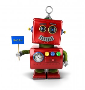 Little happy vintage toy robot holding a hello sign over white b